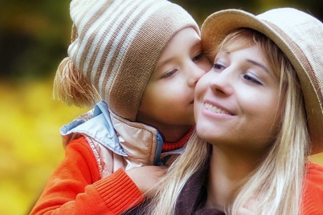 Child Kissing Mother Outdoors 1280×480