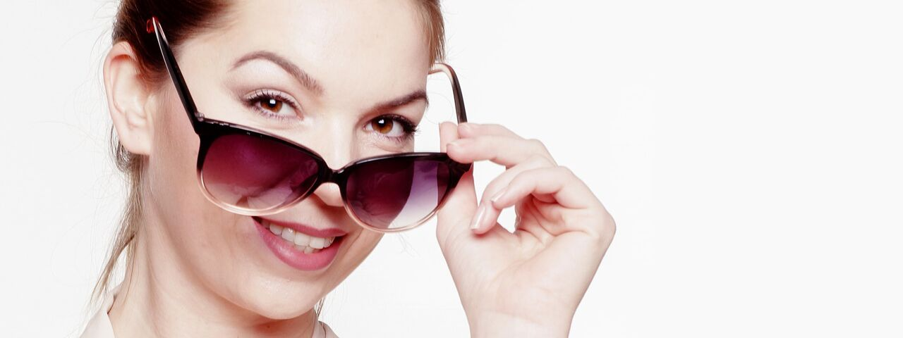 Woman20Smiling20Sunglasses201280x480_preview1.jpeg