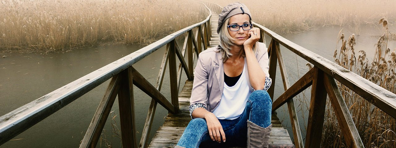 Woman Glassing Sitting Bridge