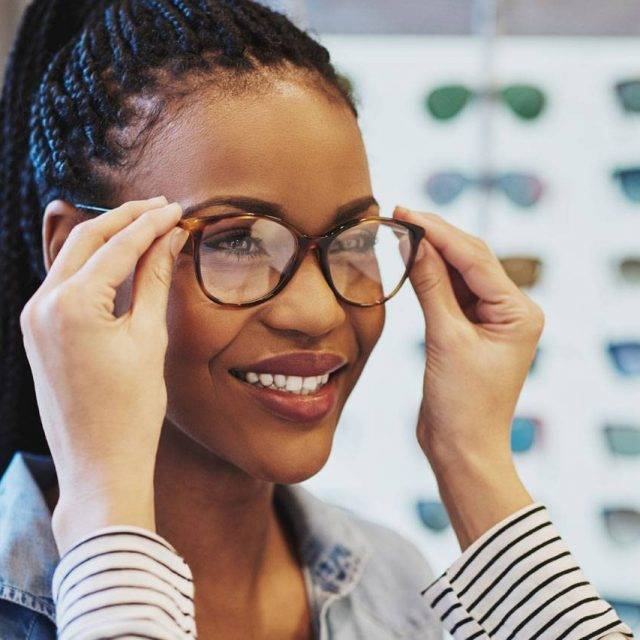 African American Woman Trying on Glasses in Wildomar