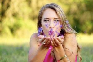 Female Blowing Purple Flowers at Colorado Springs   Executive Eyes