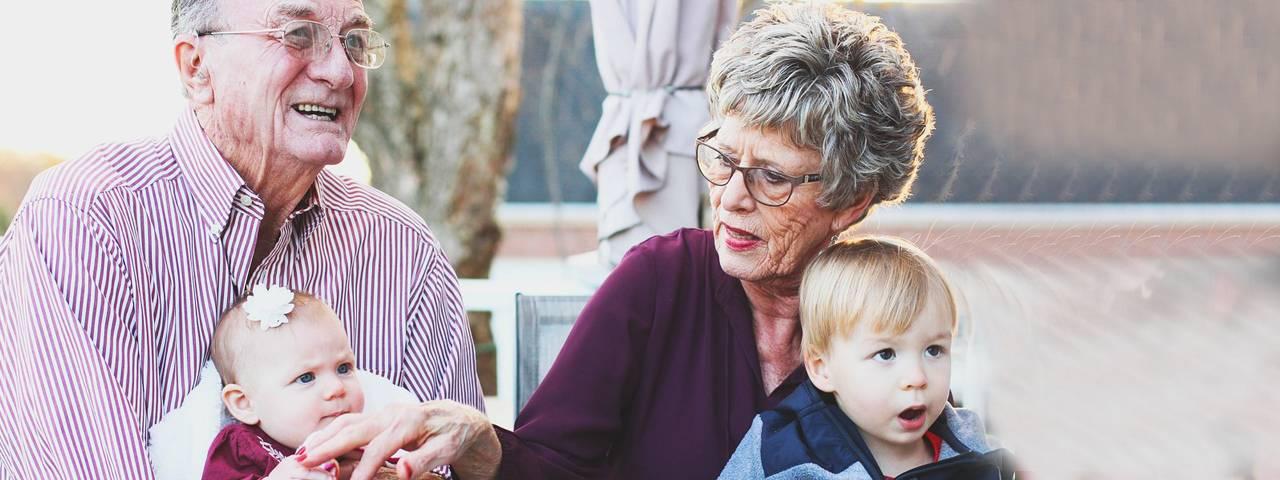 Grandparents with glasses and Grandchildren 1280x480