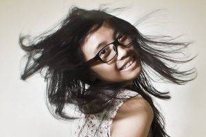 Happy Girl Flippig Hair Glasses 1280x853 300x200