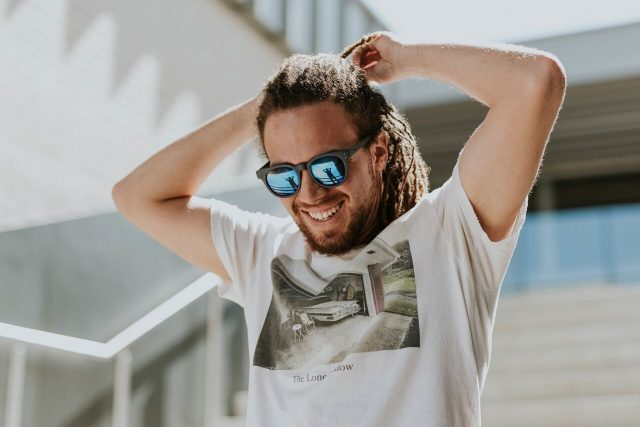 Man smiling wearing sunglasses