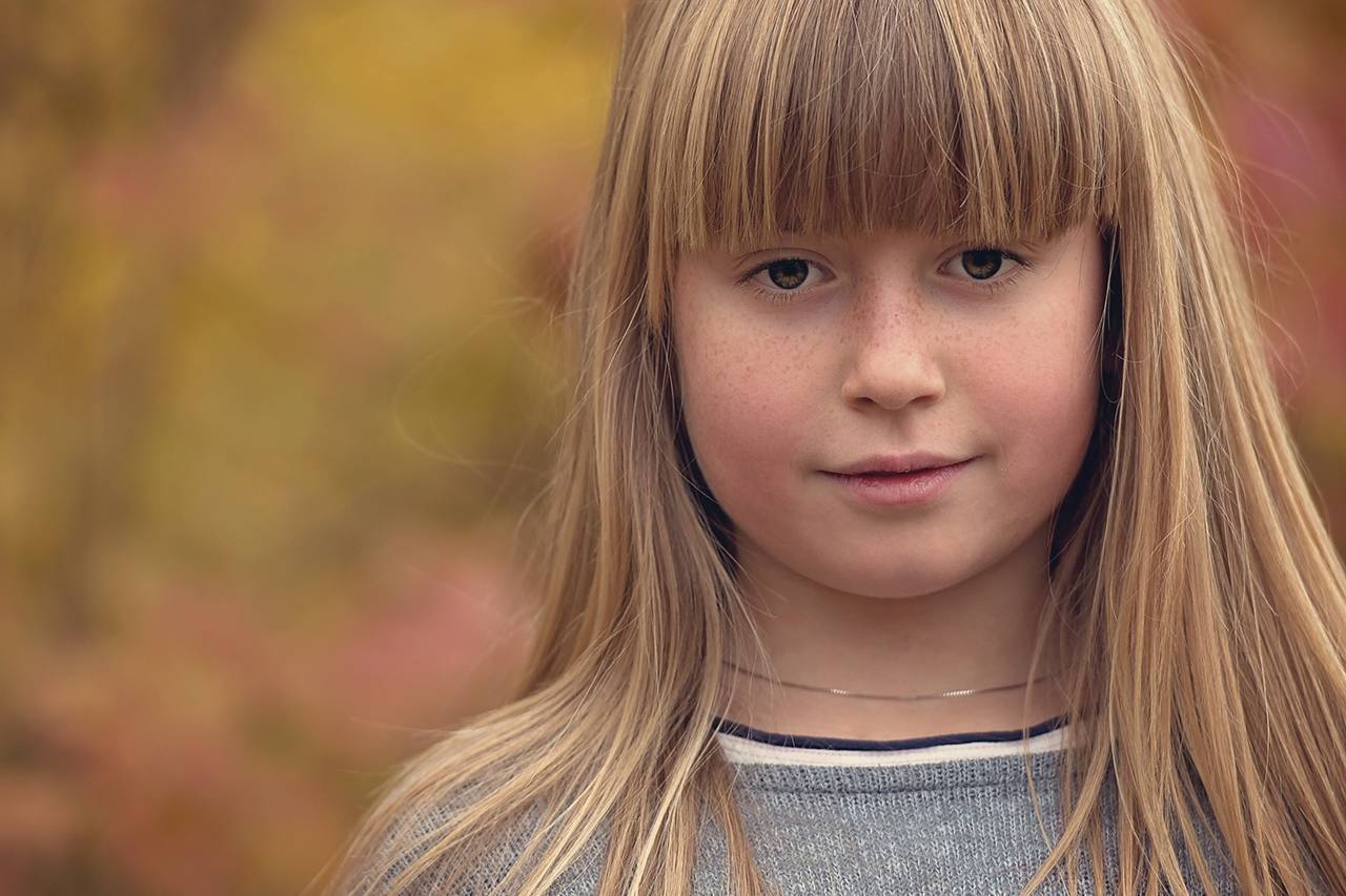 Young Blond Girl Thinking Orange Brown