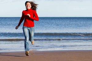 beach autumn girl running with red turtleneck | Eagle Mountain Family Eye Care in Fort Worth, TX
