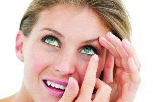 contacts woman puttingin whitebg