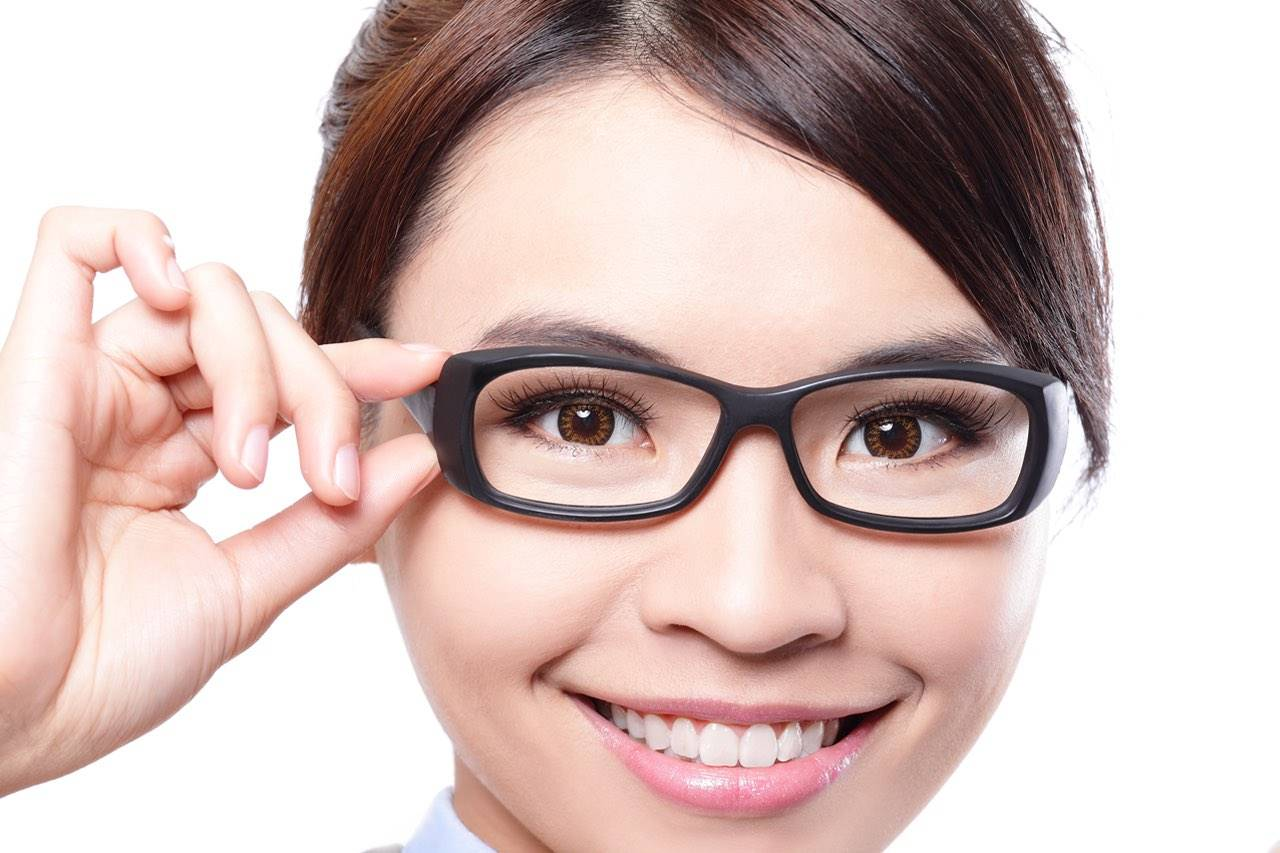 asian woman wearing designer eyeglasses