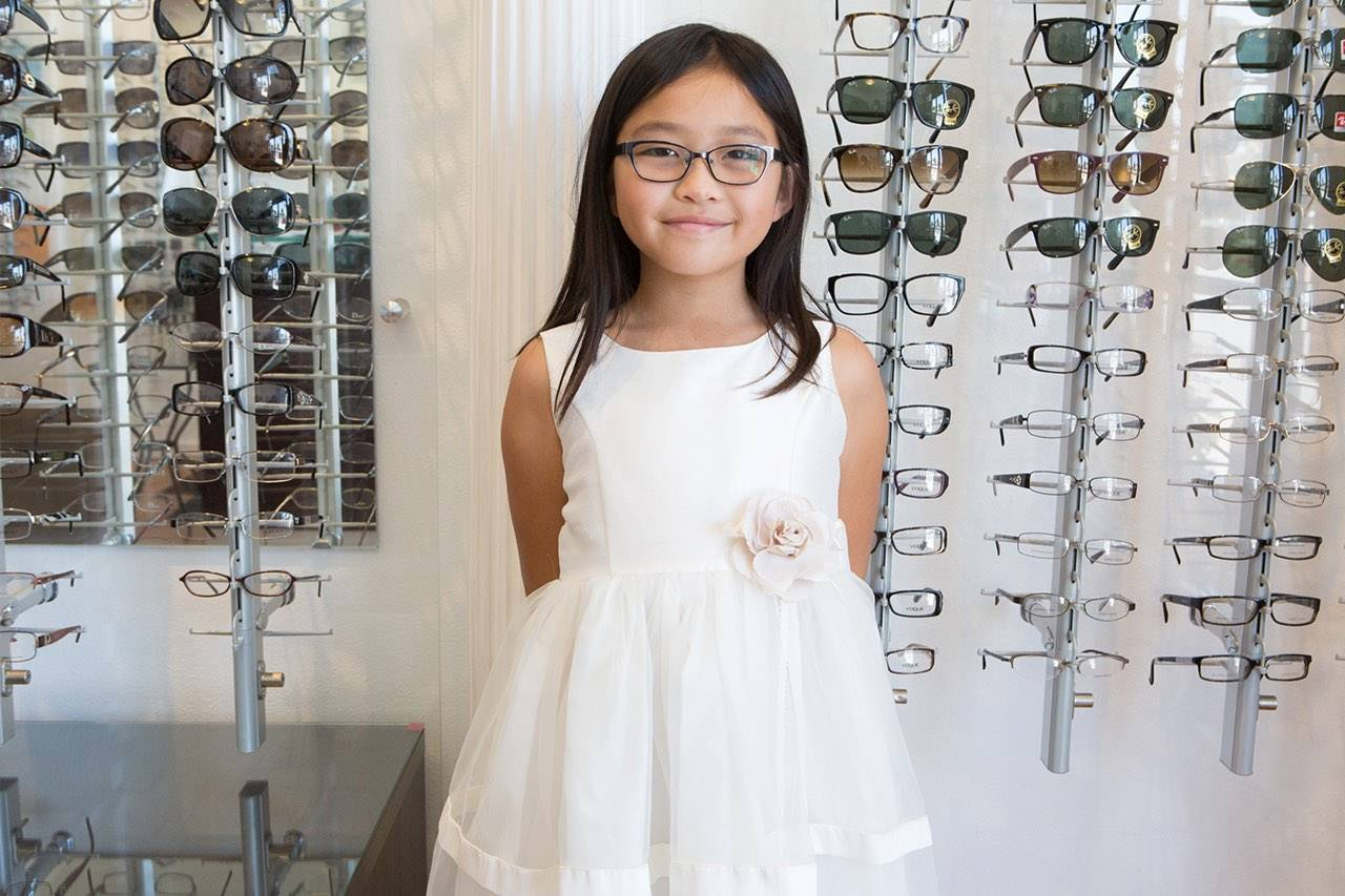 girl white dress new glasses display wall