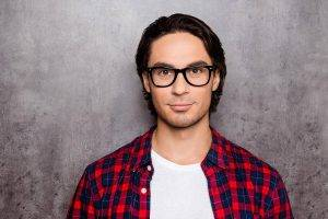 glasses on young man with dark hair wearing plaid shirt in Algonquin, IL