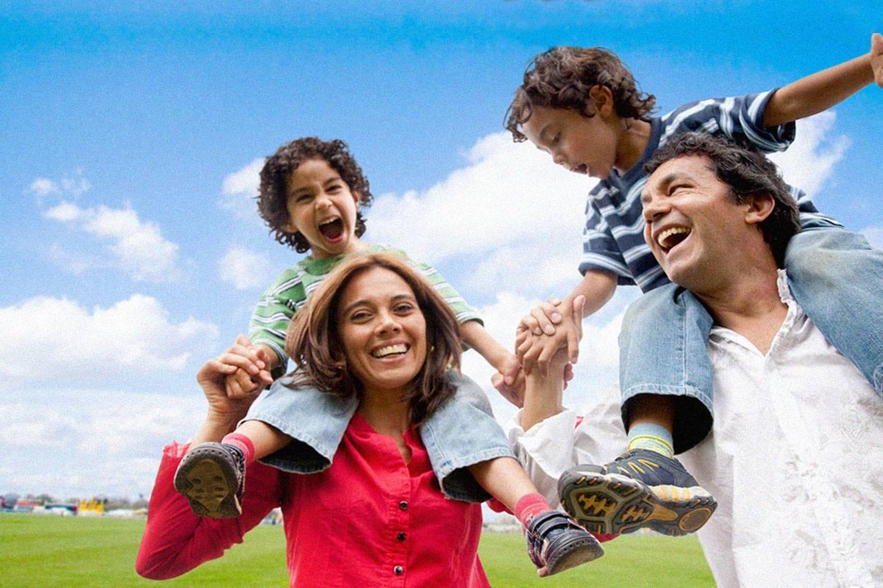 happy young family hispanic