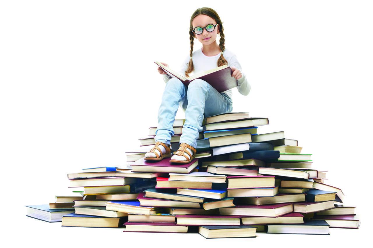 kid on book pile