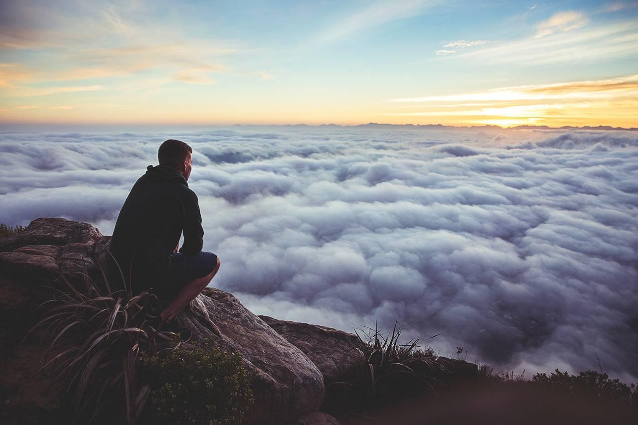 man-overlooking-clouds-1280x853