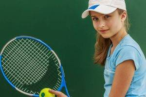 Girl wearing contact lenses, playing tennis in College Station