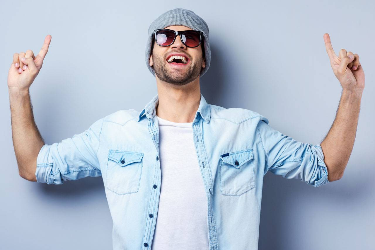 happy hipster man wearing sunglasses