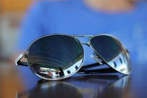 Sunglasses Blue Backround 1280×853