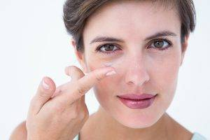 Woman holding contact lens | Family Eyecare in Millersberg, Near Wooster, OH