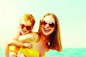 beach pic mom and son with sunglasses