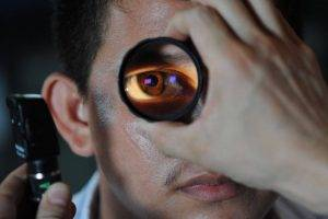 eye examination with magnified eye