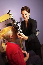 Kid getting eye exam in Bee Cave, TX