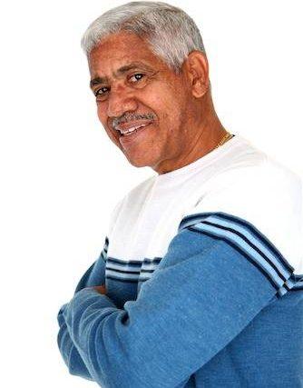 senior man with arms crossed keratoconus austin tx
