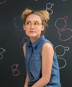 Kensie Girl Ad with blonde girl wearing yellow eyeglasses