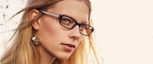 woman wearing Coach glasses