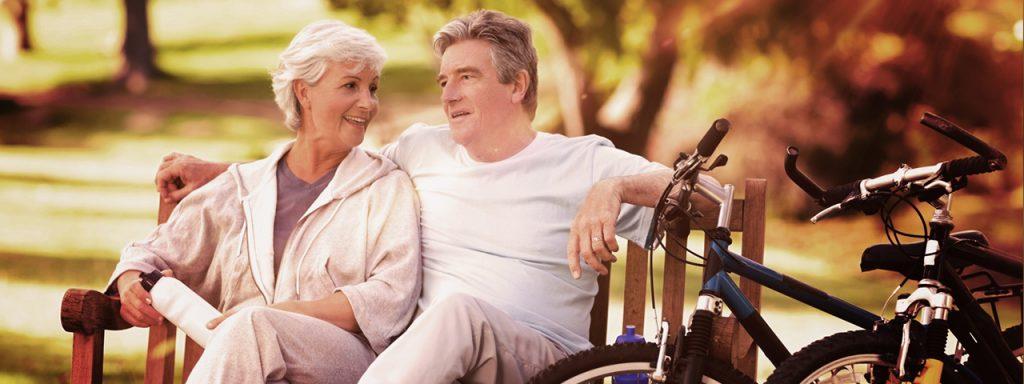 Older Couple Bench Bikes- Glaucoma Screening in Austin, Texas - Freedom Eye Care