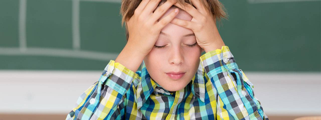 Young Boy Concentrating 1280x480