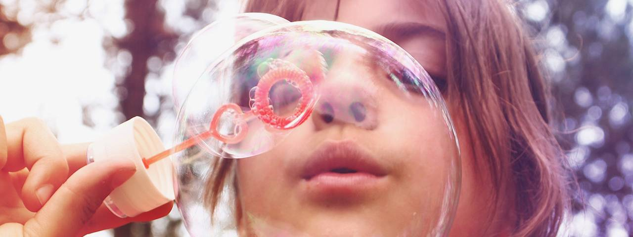 a-girl-is-blowing-bubbles