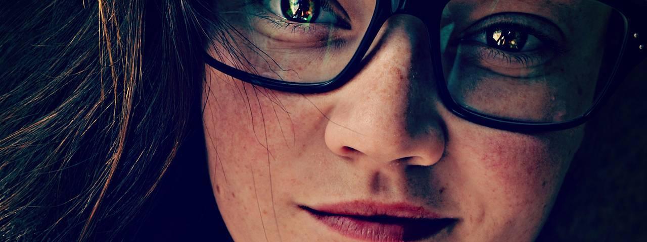 a woman  smile  glasses