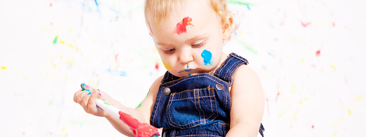 baby painting colorful closeup 1280x480