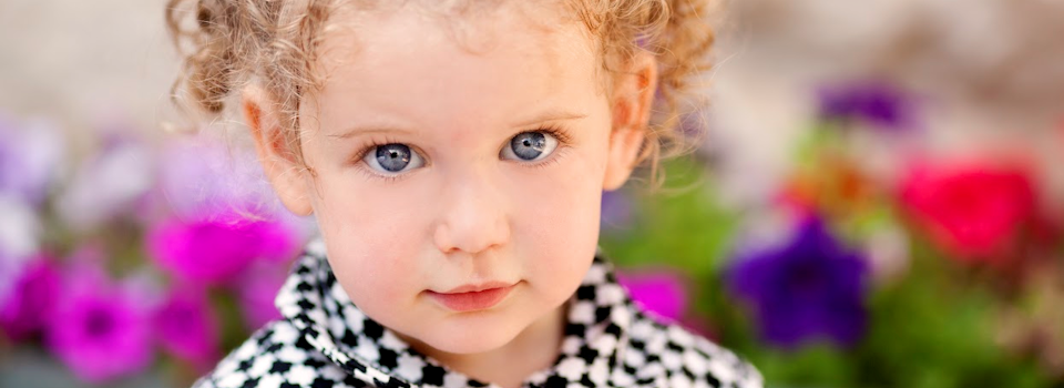 girl with blue eyes in black and white coat slide