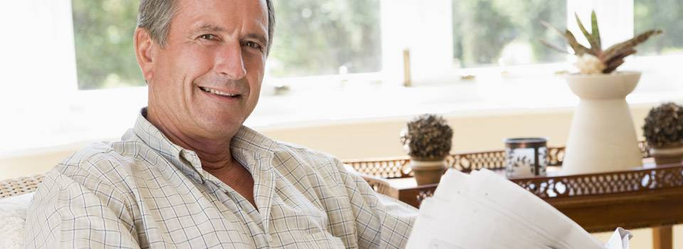 older man leaning back in chair to advertise glaucoma