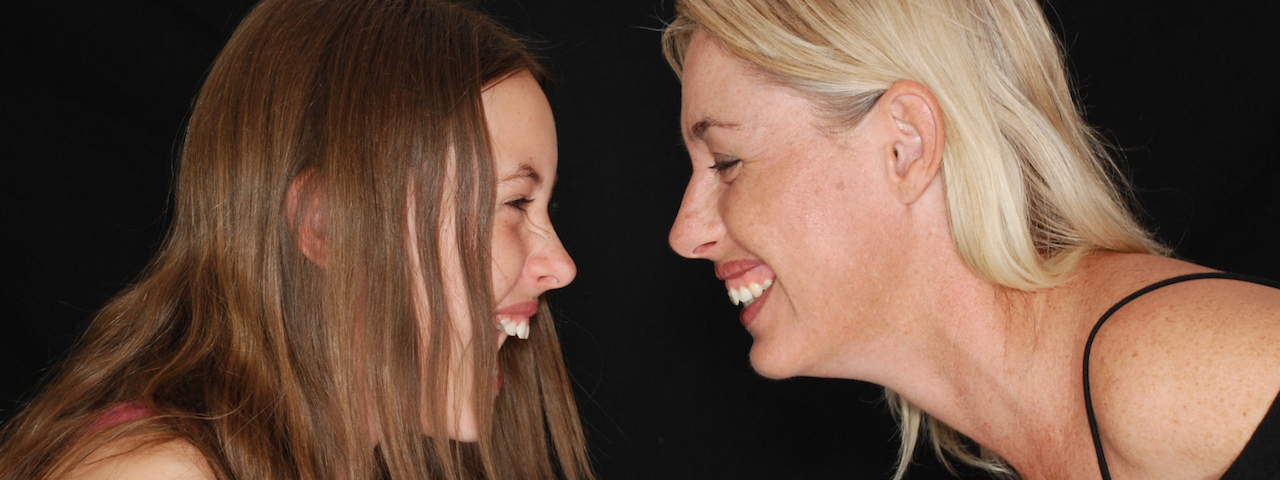 mother and daughter laughing at Europtical   eye exams and designer eyewear in Rocky River, OH