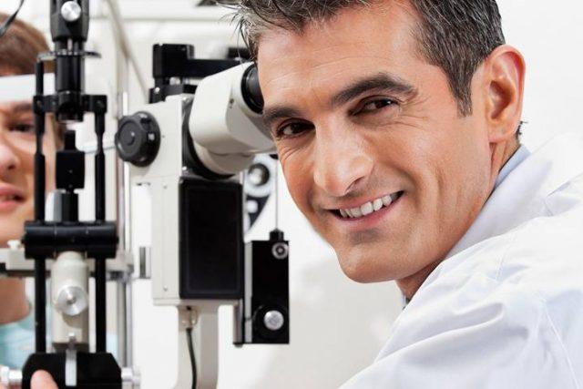 boy getting an eye exam by optometrist in fredericksburg tx