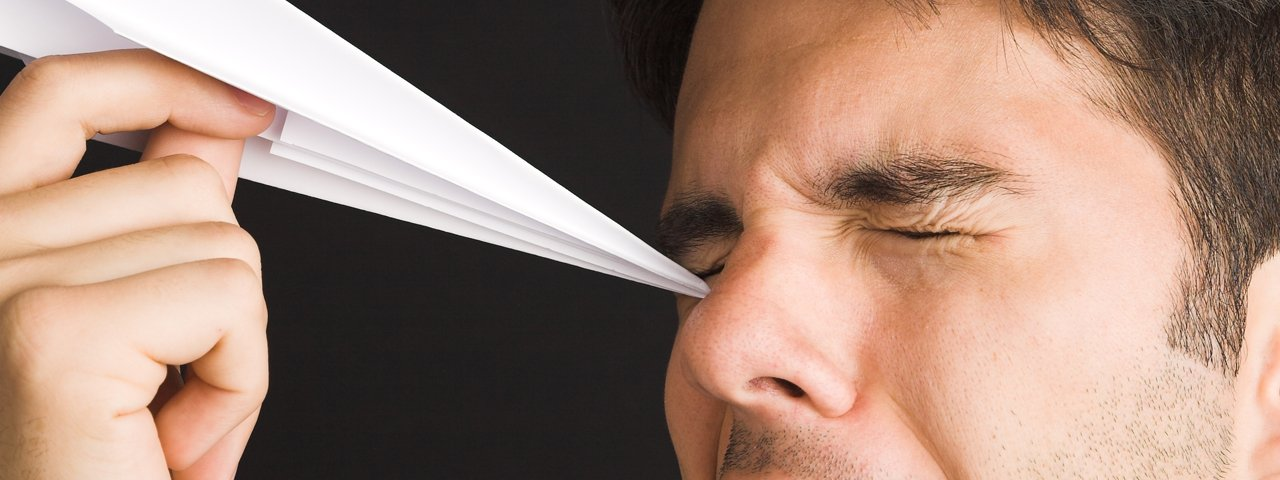 Man Poking Eye with Paper Airplane 1280x480