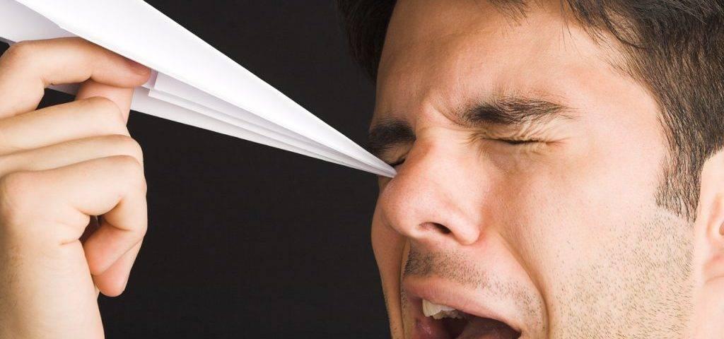 Man Poking Eye with Paper Airplane1280x853 1024x682 1024x480
