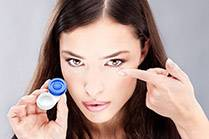 pretty brunette putting in contacts lenses in canton il