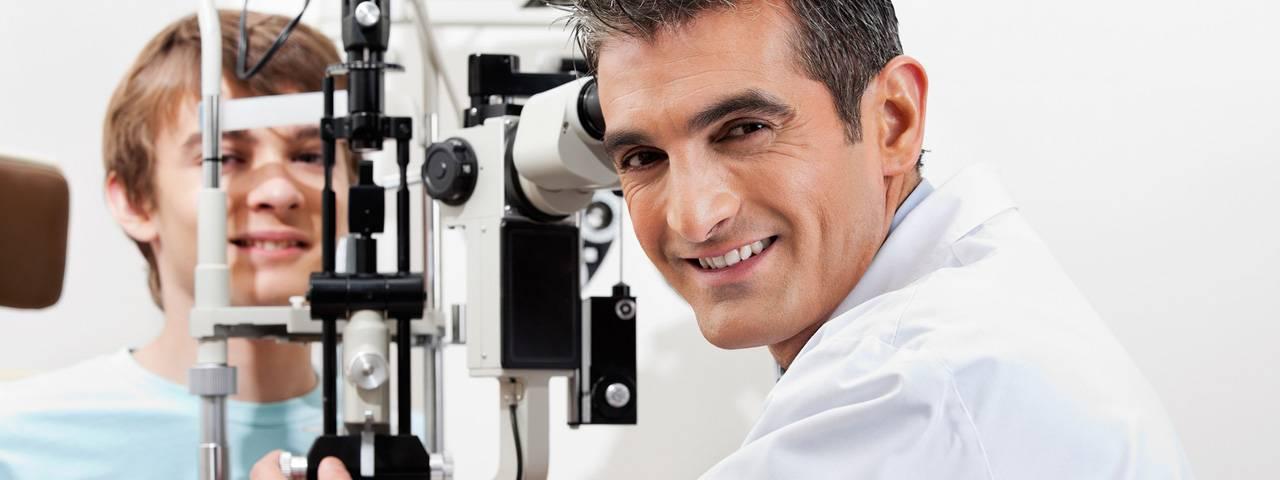 Optometrist giving Eye Exam