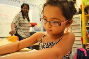 young homeschooled girl practicing hand-eye coordination task