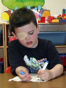 Tampa Florida boy with amblyopia eye patch coloring