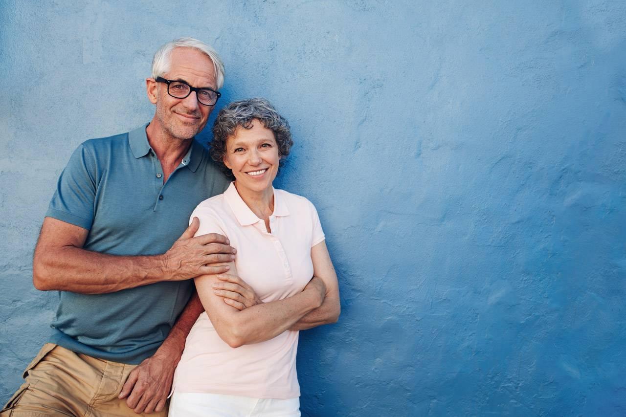older couple on a beach in jackson mi advertising cataracts