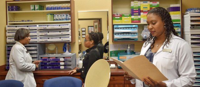 Dr Charlene and office staff in action