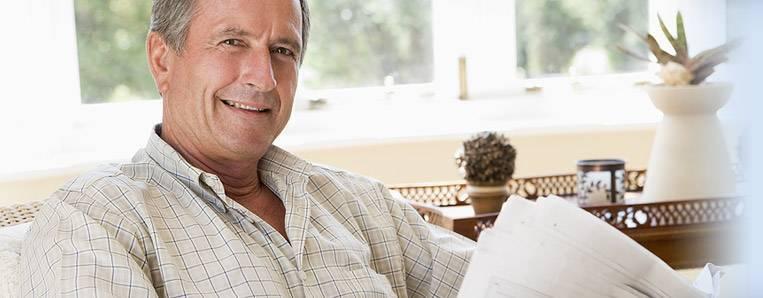 seniorman-with-paper