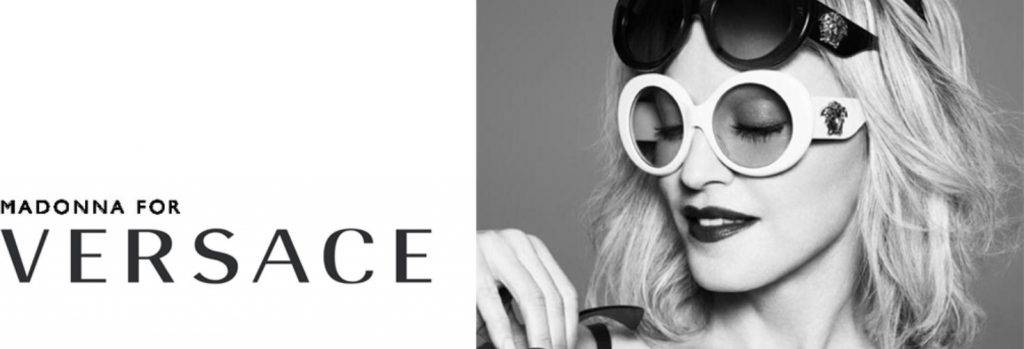 Versace ad with woman wearing two pairs of sunglasses