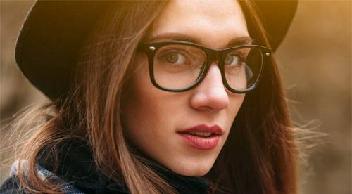 Woman in black glasses