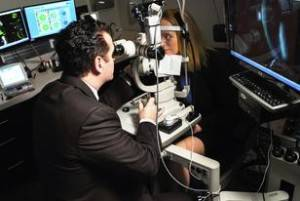 Dr. Moshe Schwartz, O.D., F.A.A.O. performing an eye exam in Baltimore, Maryland