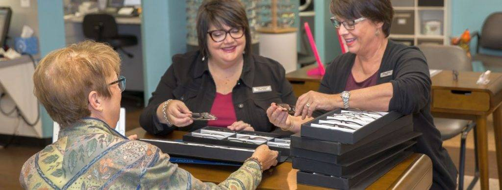 Kristin L. Campbell, OD assisting patient with eyeglasses in Eyeglasses Boutique