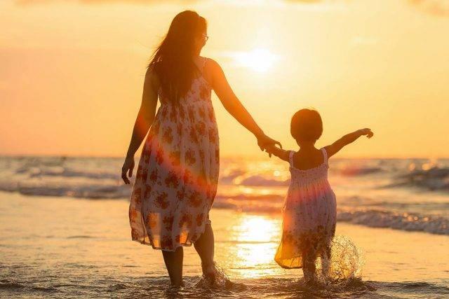Mom and child at sunset Wasaga Beach